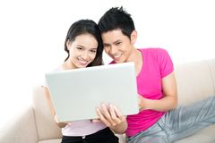 Laptop couple Stock Photos