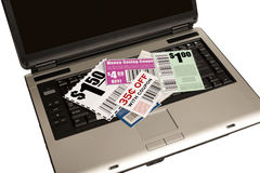 A Laptop With Coupons Represents Online Coupons XX. A laptop with coupons on top represents online coupons. XXXL Stock Image