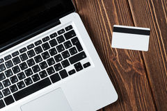 Laptop and credit card on the desk Stock Image