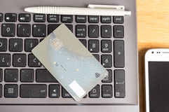 Laptop with credit card Stock Images