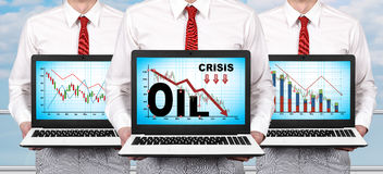 Laptop with crisis chart on screen Stock Photography