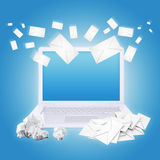 Laptop crumpled paper and envelopes. The concept of e-mailing Stock Image