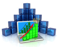 A laptop and cubic diagramatics structure. Concept of online business prosperity Royalty Free Stock Photography