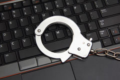 Laptop with cuffs Royalty Free Stock Images