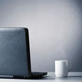 Laptop and cup Stock Image