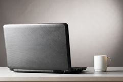 Laptop and cup Royalty Free Stock Images