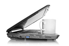 Laptop with cup Royalty Free Stock Images