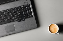 Laptop with cup of coffee Stock Photos