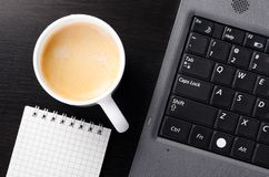 Laptop with cup of coffee Royalty Free Stock Photography