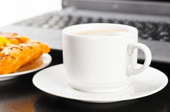 Laptop and cup of coffee Stock Photography