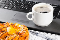 Laptop and cup of coffee Stock Photos