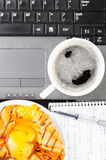 Laptop and cup of coffee Royalty Free Stock Photo