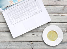 Laptop and a cup of coffee with crema Stock Photography