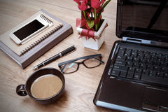 Laptop and cup of coffee with flower on desk Stock Photography