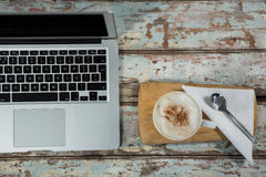 Laptop with cup of coffee Stock Images