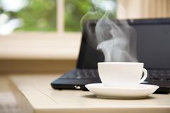 Laptop and a cup of coffee Royalty Free Stock Photos