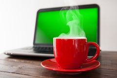 Laptop and a cup of coffee Royalty Free Stock Images
