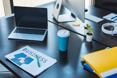 Laptop and cup of coffee on table. In office Stock Photo