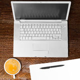 Laptop and cup of coffee Stock Photo