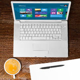 Laptop and cup of coffee Stock Images