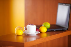Laptop,cup and fruits Stock Photography