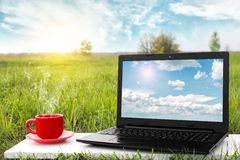 Laptop and cup of hot coffee on the table, outdoor office. Traveling by airplane. Travel concept. Business ideas. stock photos