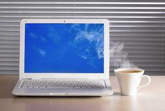 Laptop and a cup of tea. Royalty Free Stock Photography
