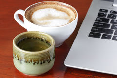 Laptop and a cup of tea. Coffee Stock Images