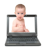 Laptop with cute baby on screen Stock Images