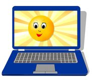 Laptop with cute sun face on display Royalty Free Stock Photo