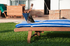 Laptop on deckchair Royalty Free Stock Images