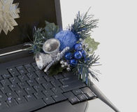 Laptop Decked Out For Christmas. Laptop computer with Christmas decorations Royalty Free Stock Photography