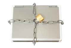 Laptop in den Ketten lizenzfreie stockfotografie
