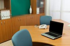 Laptop on a desk Stock Image
