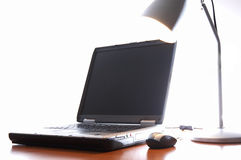 The laptop on the desk stock photo
