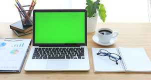 Laptop on desk with green screen. stock footage