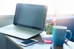 Laptop on desk at home. Small business concept. Black screen Laptop on desk at home. Small business and technology concept royalty free stock image