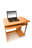 Laptop and desk isolated Stock Image