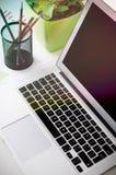 Laptop on desk in modern office mockup Stock Photo