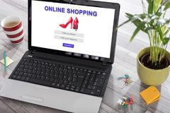 Online shopping concept on a laptop. Laptop on a desk with online shopping concept on the screen royalty free stock photography