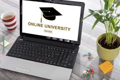 Online university concept on a laptop royalty free stock images