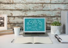 Laptop on desk with sketchbook showing white design doodles against teal background. Digital composite of Laptop on desk with sketchbook showing white design Stock Photos