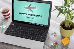 Travel insurance concept on a laptop. Laptop on a desk with travel insurance concept on the screen royalty free stock image