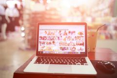 Laptop desktop shopping online and mall blurred. Backgrounds royalty free stock photography