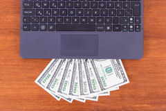 Laptop Detail and Banknotes Stock Photo