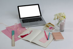 Laptop, diary, ruler, pages, sticky notes, flowers and pencil Royalty Free Stock Image