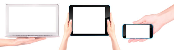 Laptop, digital tablet and mobile phone with hand Royalty Free Stock Photos