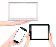 Laptop, digital tablet and mobile phone with hand Stock Images