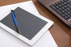Laptop and Digital Tablet on the Worktable Royalty Free Stock Photography
