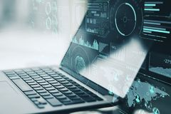 Laptop and digital world map. Double exposure of laptop and digital world map with financial chart at night city background. 3D rendering Royalty Free Stock Photography